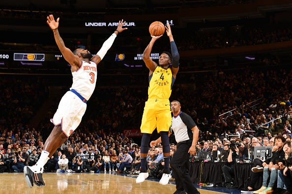 Victor Oladipo #4 of the Indiana Pacers shoots the ball against Tim Hardaway Jr. #3 of the New York Knicks on October 31, 2018 at Madison Square Garden in New York City, New York.