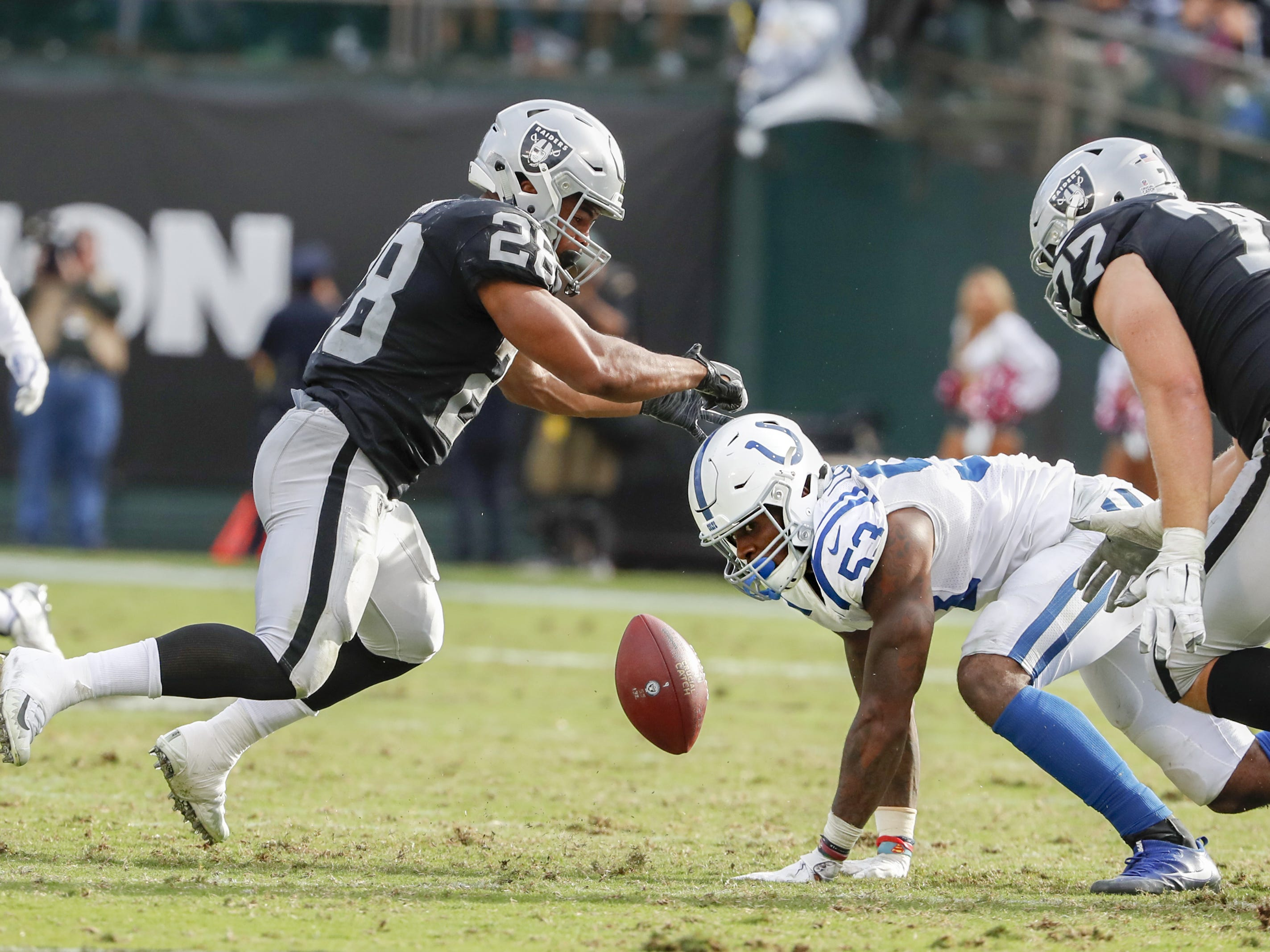 Leonard forces a fumble on Oakland Raiders running back Doug Martin duringtheir game Oct. 28 at The Coliseum in Oakland, California.