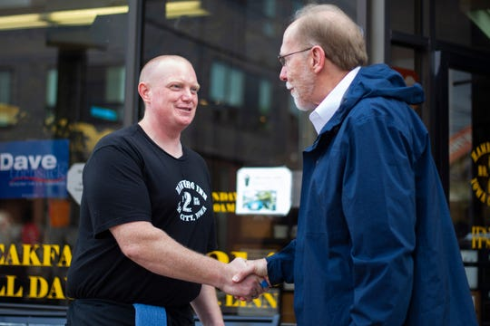 U.S. Rep. Dave Loebsack, D-Iowa, shakes hands with Seth Dudley after a visit on Thursday morning, Nov. 1, 2018, outside Hamburg Inn No. 2 on Linn Street in Iowa City.