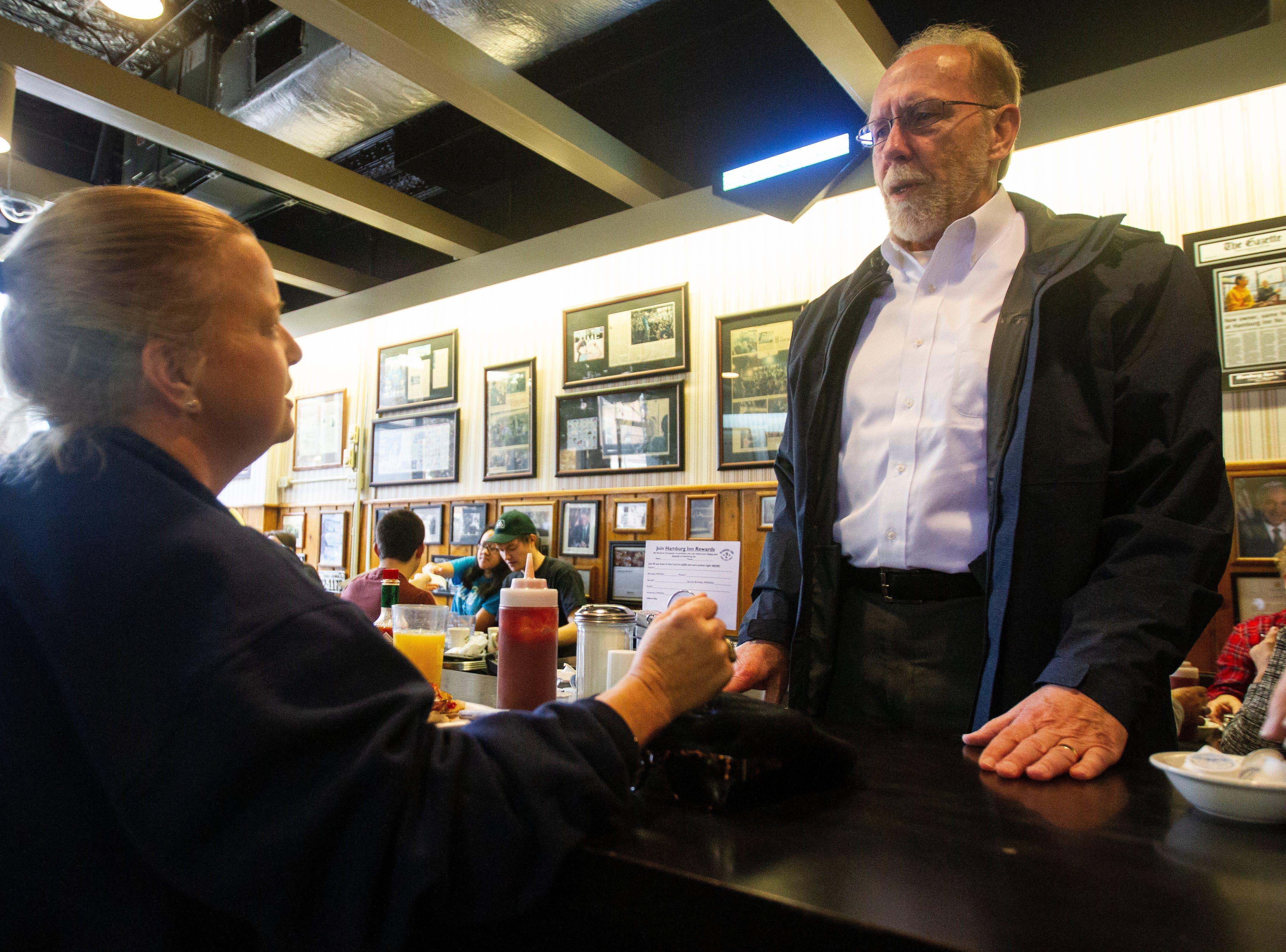 U.S. Rep. Dave Loebsack, D-Iowa, talks with Ara Carbonneau, of Coralville on Thursday morning, Nov. 1, 2018, at Hamburg Inn No. 2 on Linn Street in Iowa City.