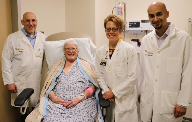 UIHC doctors hit a state milestone. They performed the first minimally invasive tricuspid valve repair in Iowa. The 77-year-old patient poses for a picture with cardiologist  Dr. Philip Horwitz, nurse practitioner Lana Goldsmith and surgeon Dr. Mohammad Bashir.
