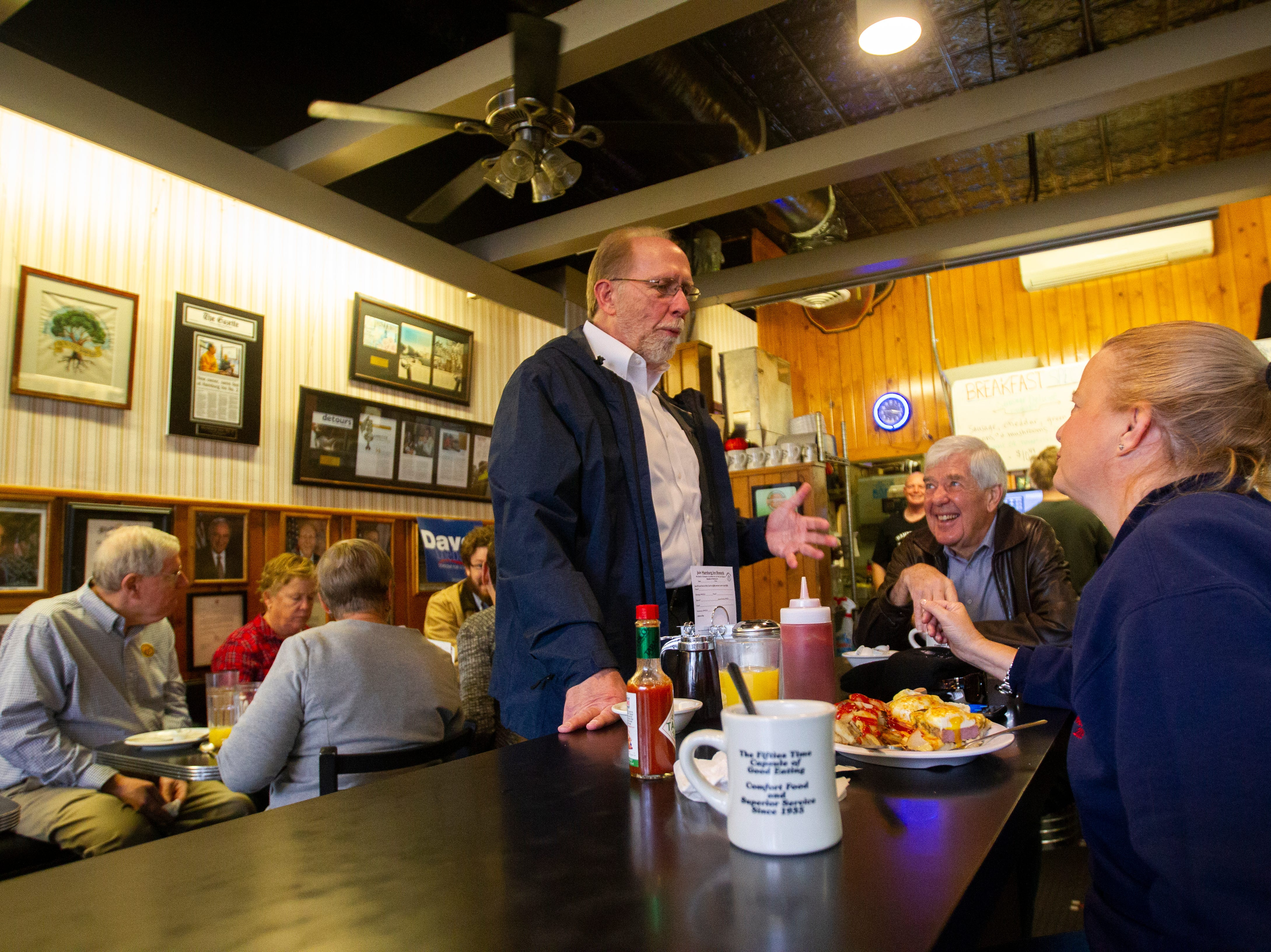 U.S. Rep. Dave Loebsack, D-Iowa, (center) talks with Gary Wicklund and Ara Carbonneau, both of Coralville on Thursday morning, Nov. 1, 2018, at Hamburg Inn No. 2 on Linn Street in Iowa City.