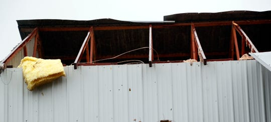 A blown roof over this farm shop in Roxie, Miss., was proof that either a strong storm or tornado hit the community, early Thursday, Nov. 1, 2018. Strong storms and several possible tornadoes hit throughout Mississippi during early morning hours. (AP Photo/Rogelio V. Solis)