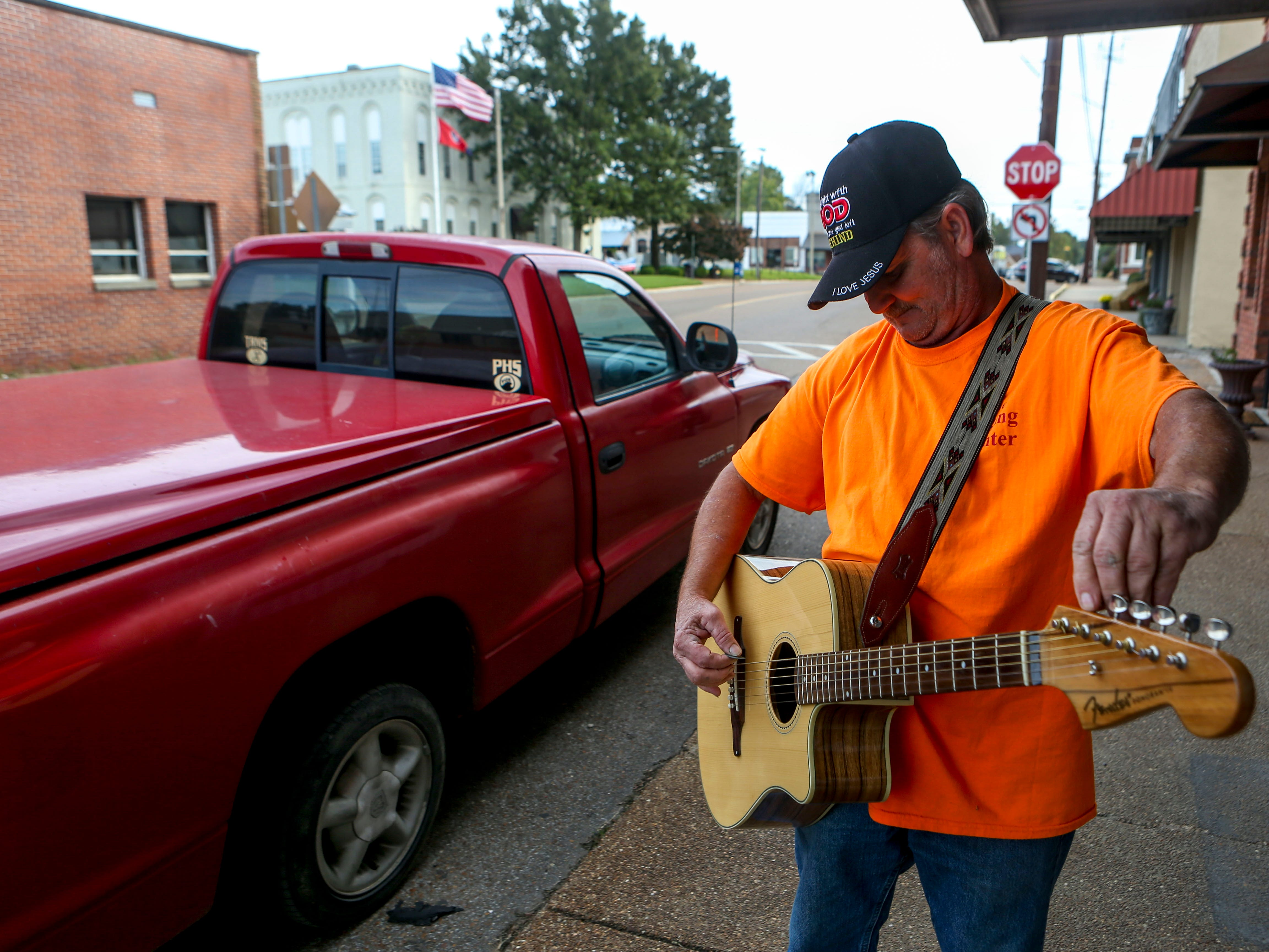Scott French plays a song and shares his life story of addiction, redemption, and finding purpose outside of the church he plays guitar for at New Life Church in Alamo, Tenn., on Wednesday, Oct. 24, 2018.