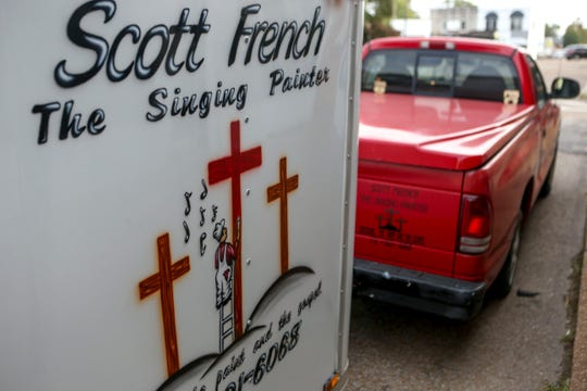 Scott French parks his truck and trailer, both donning his logos, outside of the church he plays guitar for at New Life Church in Alamo, Tenn., on Wednesday, Oct. 24, 2018.
