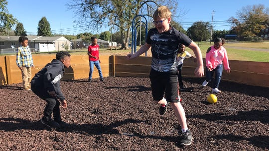 Fourth grader Kory Ball tries to avoid getting hit during a game of Gaga ball on Oct. 24.