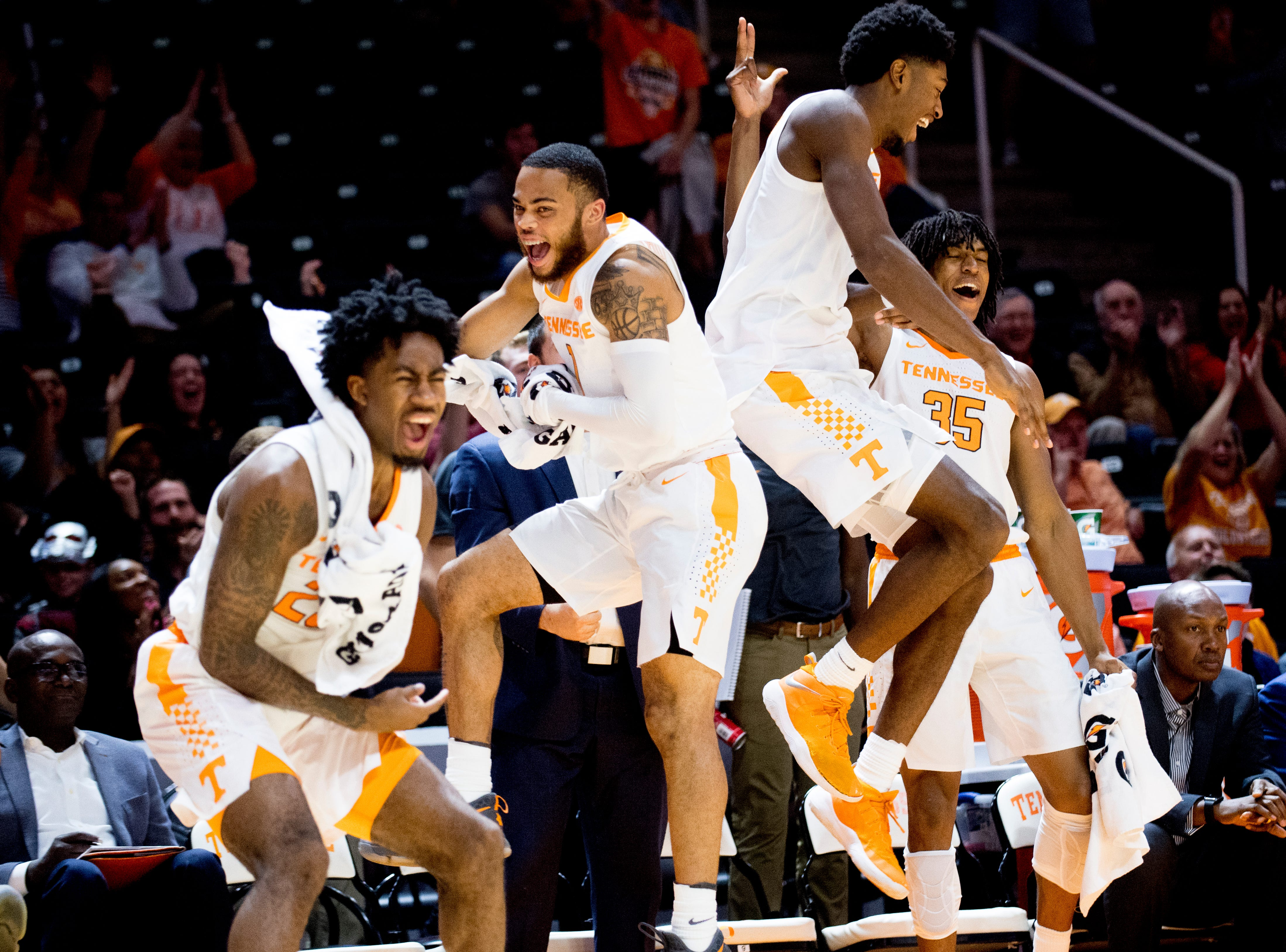 Tennessee guard Lamonte Turner (1) and Tennessee forward Kyle Alexander (11) celebrate mid-air after a point during a game between Tennessee and Tusculum at Thompson-Boling Arena in Knoxville, Tennessee on Wednesday, October 31, 2018.