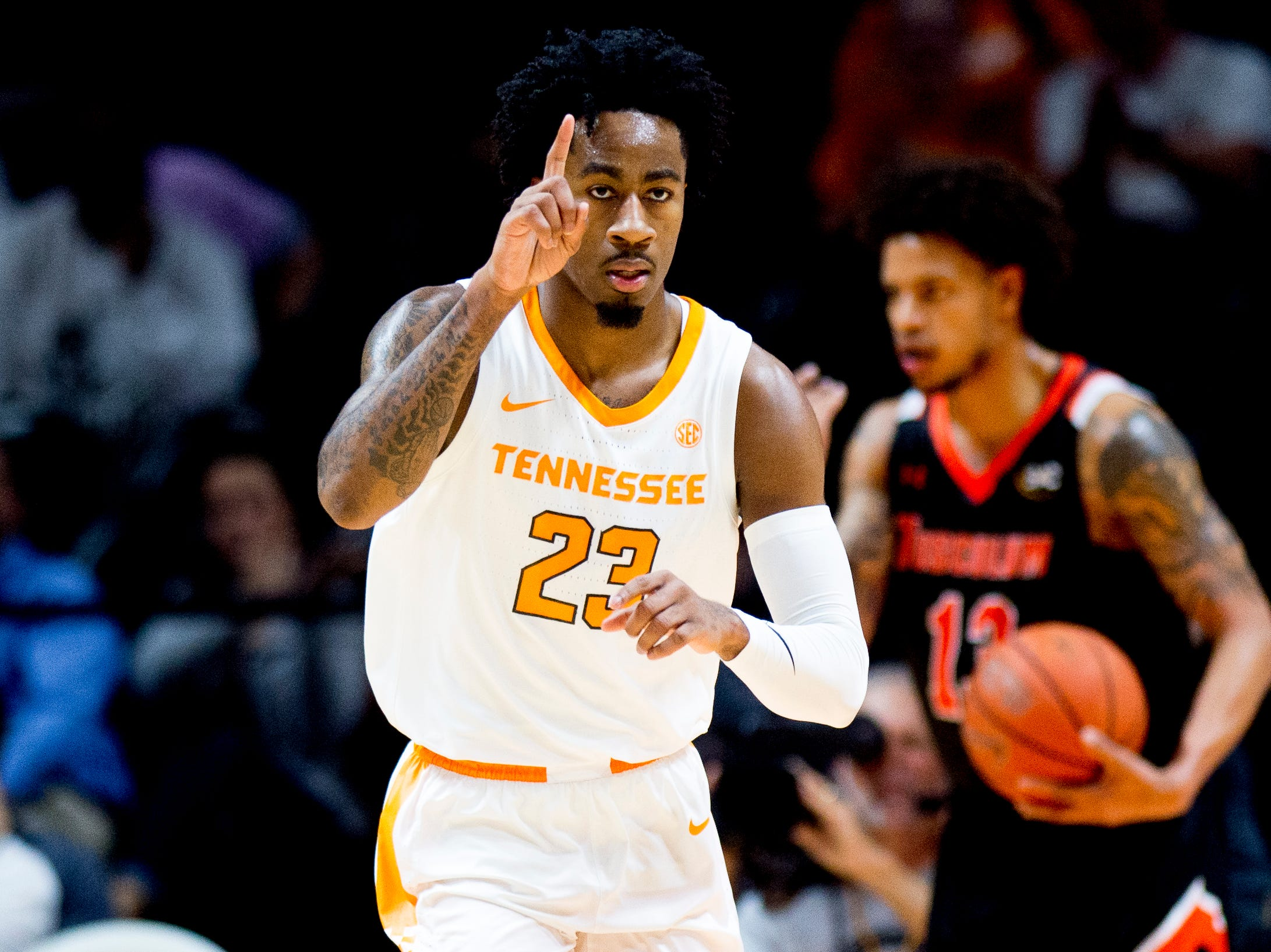 Tennessee guard Jordan Bowden (23) reacts after making a dunk during a game between Tennessee and Tusculum at Thompson-Boling Arena in Knoxville, Tennessee on Wednesday, October 31, 2018.