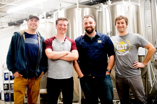 From left, owners Shane Todd, Chris Hall, Dan Leonard and Chris Sexton pose for a photo in front of the fermentation and brite tanks at Elst Brewing Company on 2417 N. Central St. in Knoxville on Nov. 1, 2018.