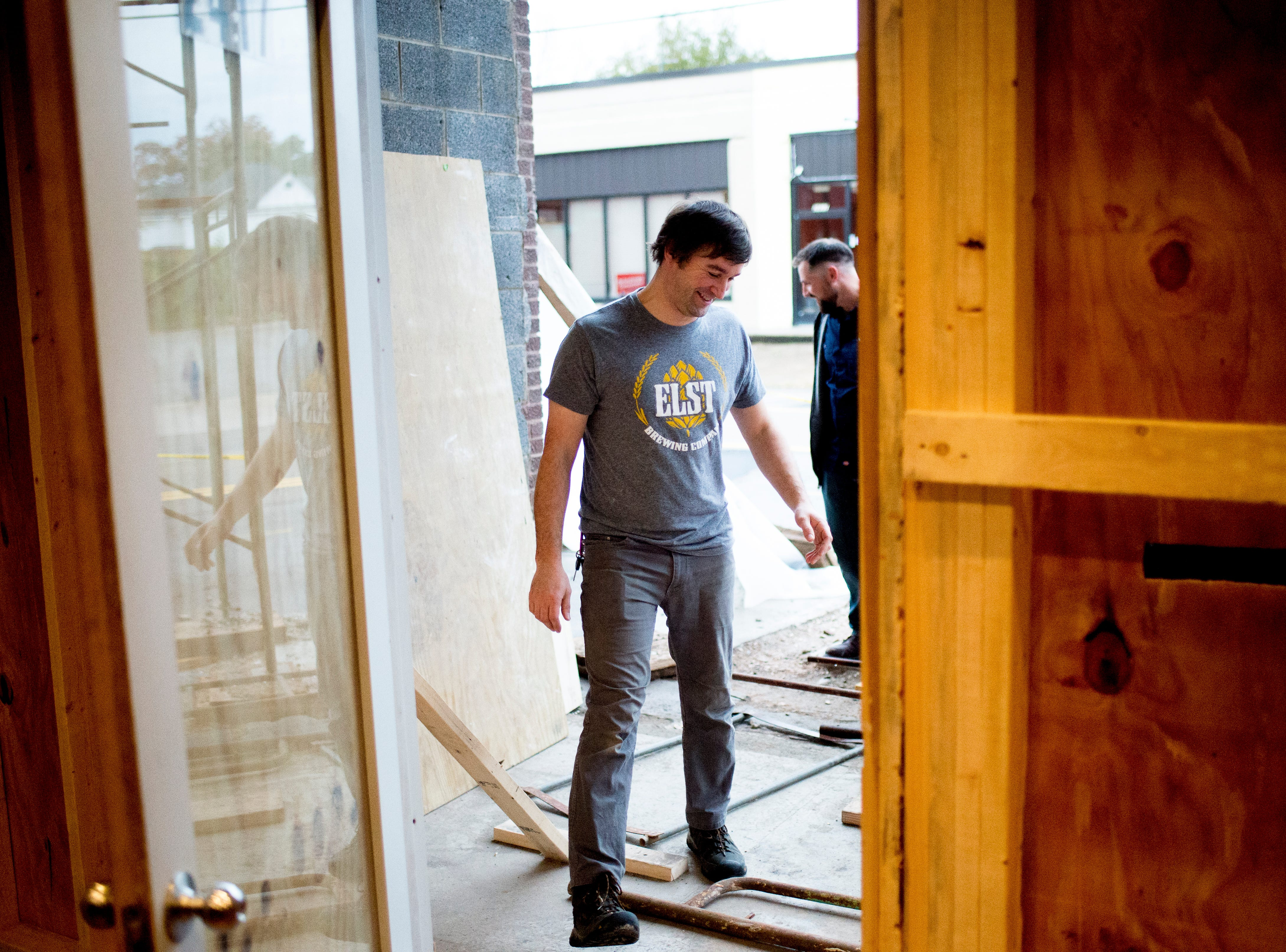 Chris Sexton walks through the entrance still undergoing construction at Elst Brewing Company on 2417 N Central St. in Knoxville, Tennessee on Thursday, November 1, 2018. Elst plans to open its door beginning next year.