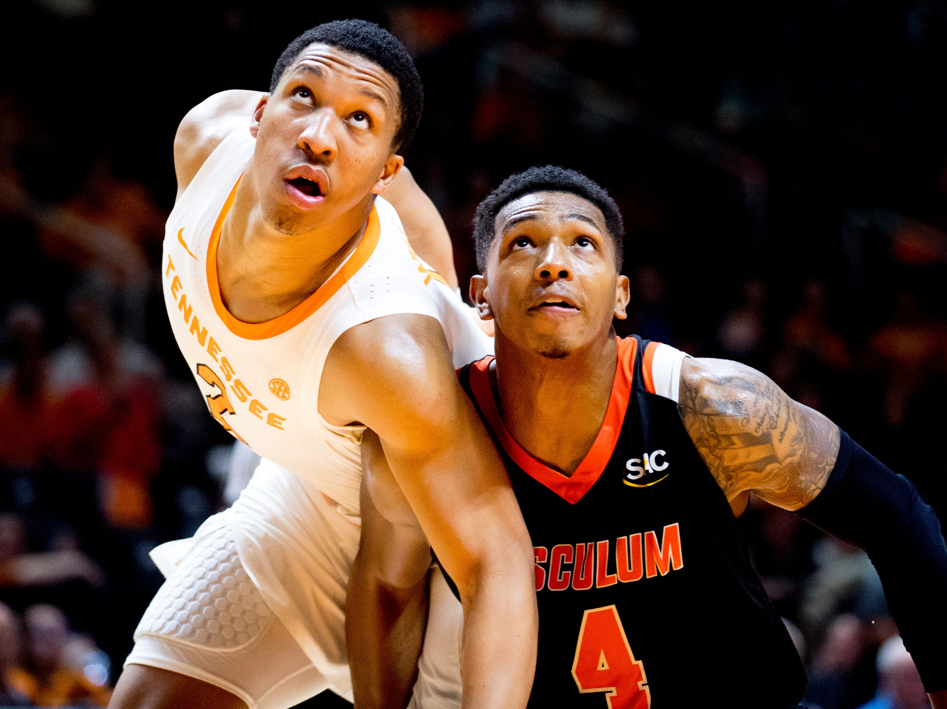 Tennessee forward Grant Williams (2) and Tusculum guard Jackie Davis (4) eye the ball during a game between Tennessee and Tusculum at Thompson-Boling Arena in Knoxville, Tennessee on Wednesday, October 31, 2018.