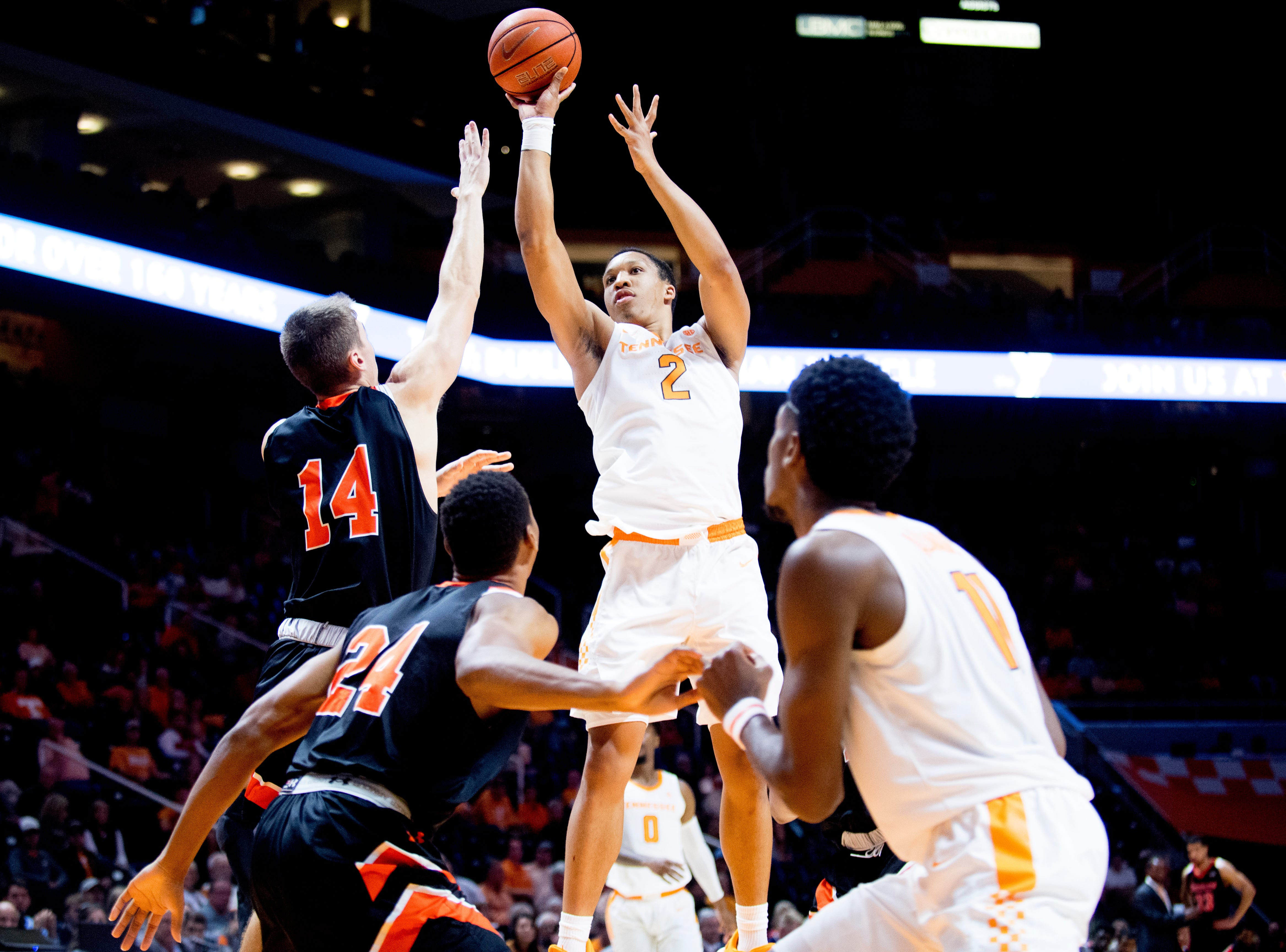 Tennessee forward Grant Williams (2) shoots past Tusculum forward Caleb Hodnett (14) during a game between Tennessee and Tusculum at Thompson-Boling Arena in Knoxville, Tennessee on Wednesday, October 31, 2018.