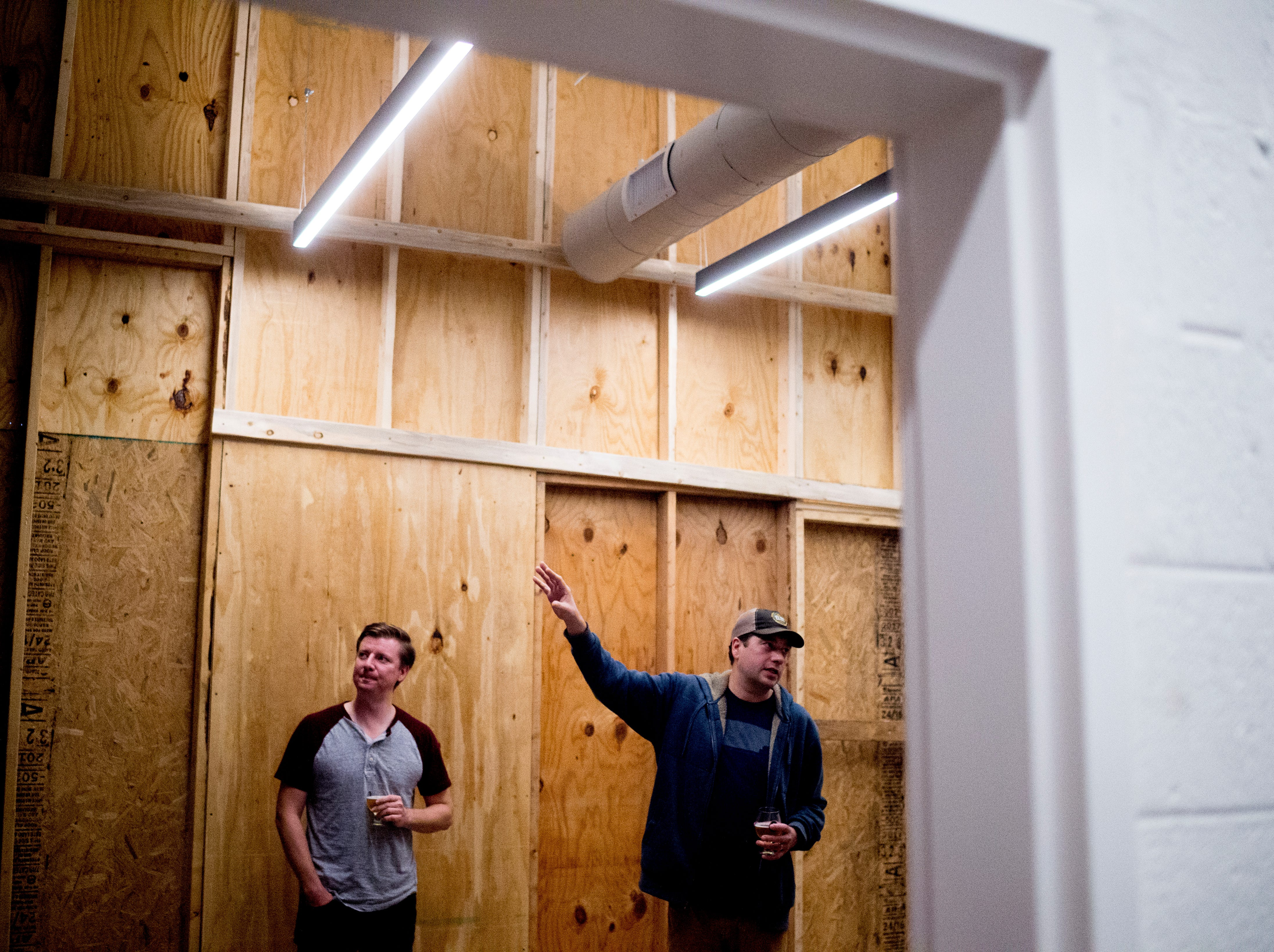 Chris Hall and Shane Todd give a tour of the lobby area of the brewery at Elst Brewing Company on 2417 N Central St. in Knoxville, Tennessee on Thursday, November 1, 2018. Elst plans to open its door beginning next year.