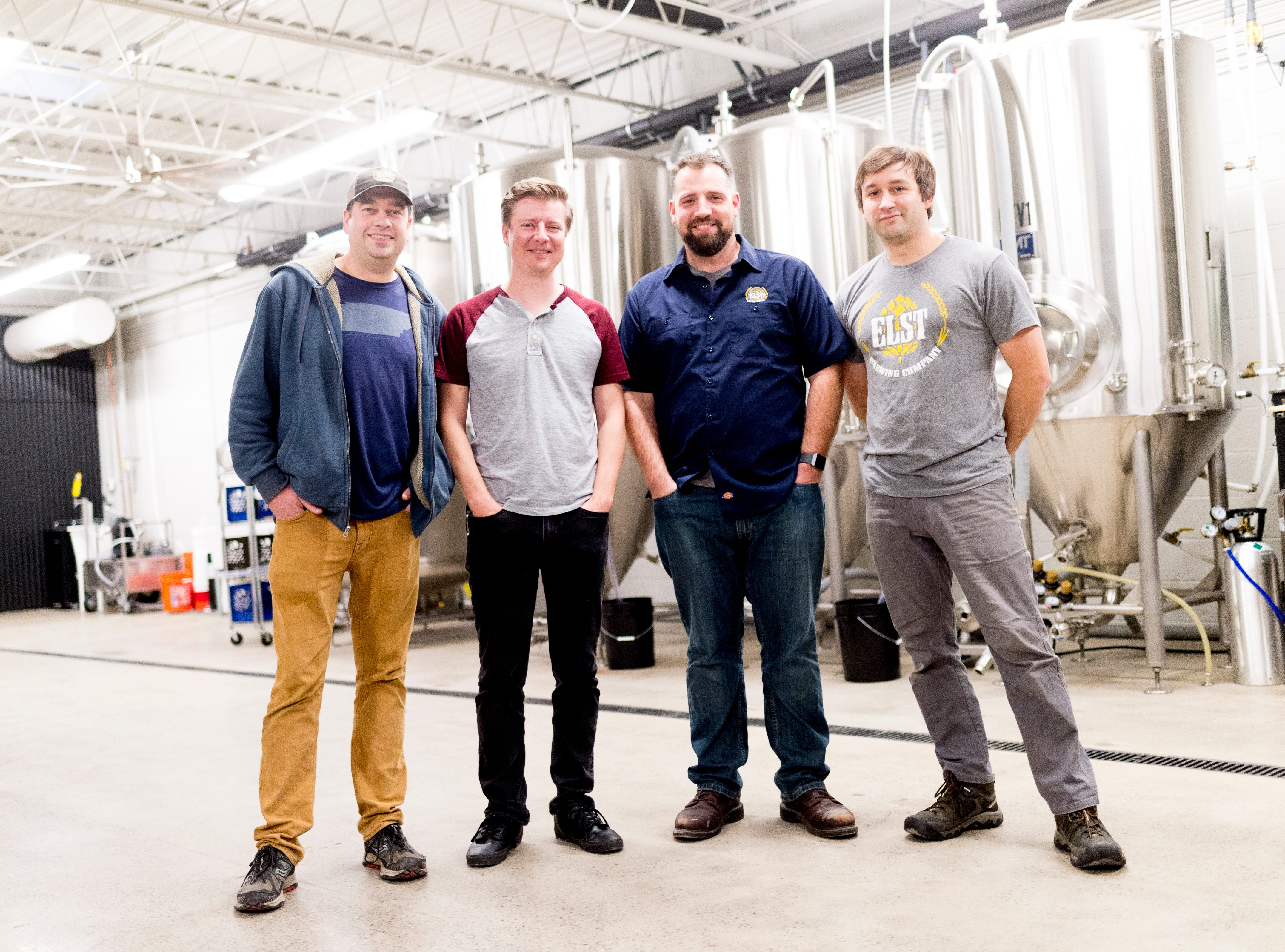 From left, owners Shane Todd, Chris Hall, Dan Leonard and Chris Sexton pose for a photo in front of the fermentation and brite tanks at Elst Brewing Company on 2417 N Central St. in Knoxville, Tennessee on Thursday, November 1, 2018. Elst plans to open its door beginning next year.