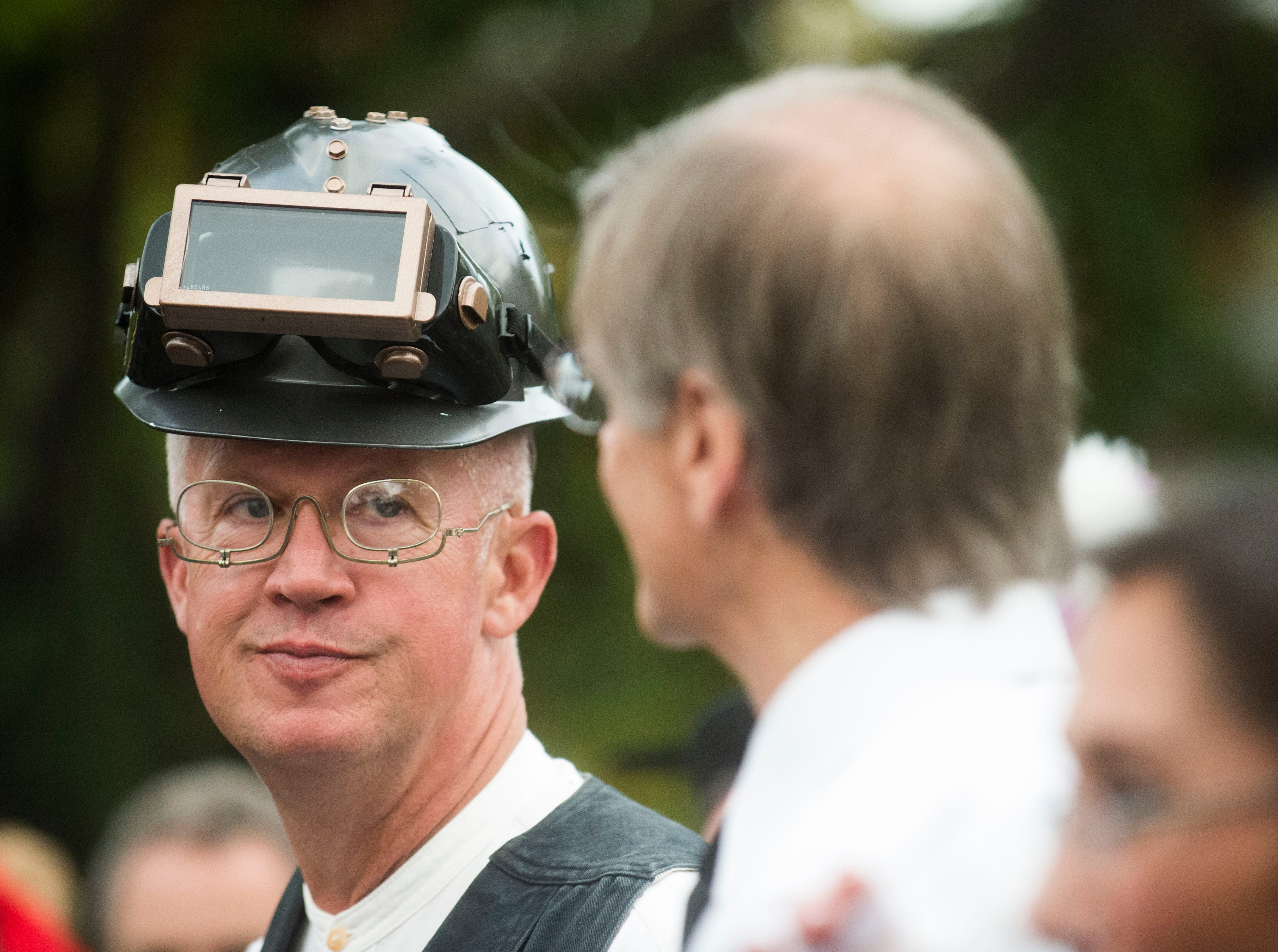Charlie Harley, dressed as a steam punk engineer, speaks with friends at the Fourth and Gill neighborhood Halloween party in Knoxville, Wed. Oct. 31, 2018.