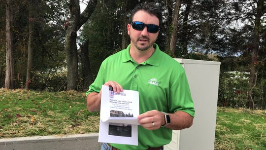 Josh Sanderson of Smithbilt Homes holds the U.S. Postal Service instruction packet he received on installing cluster mailboxes in new single-family subdivisions.