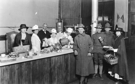 World War I soldiers visit a Red Cross canteen at the Southern Railway station.