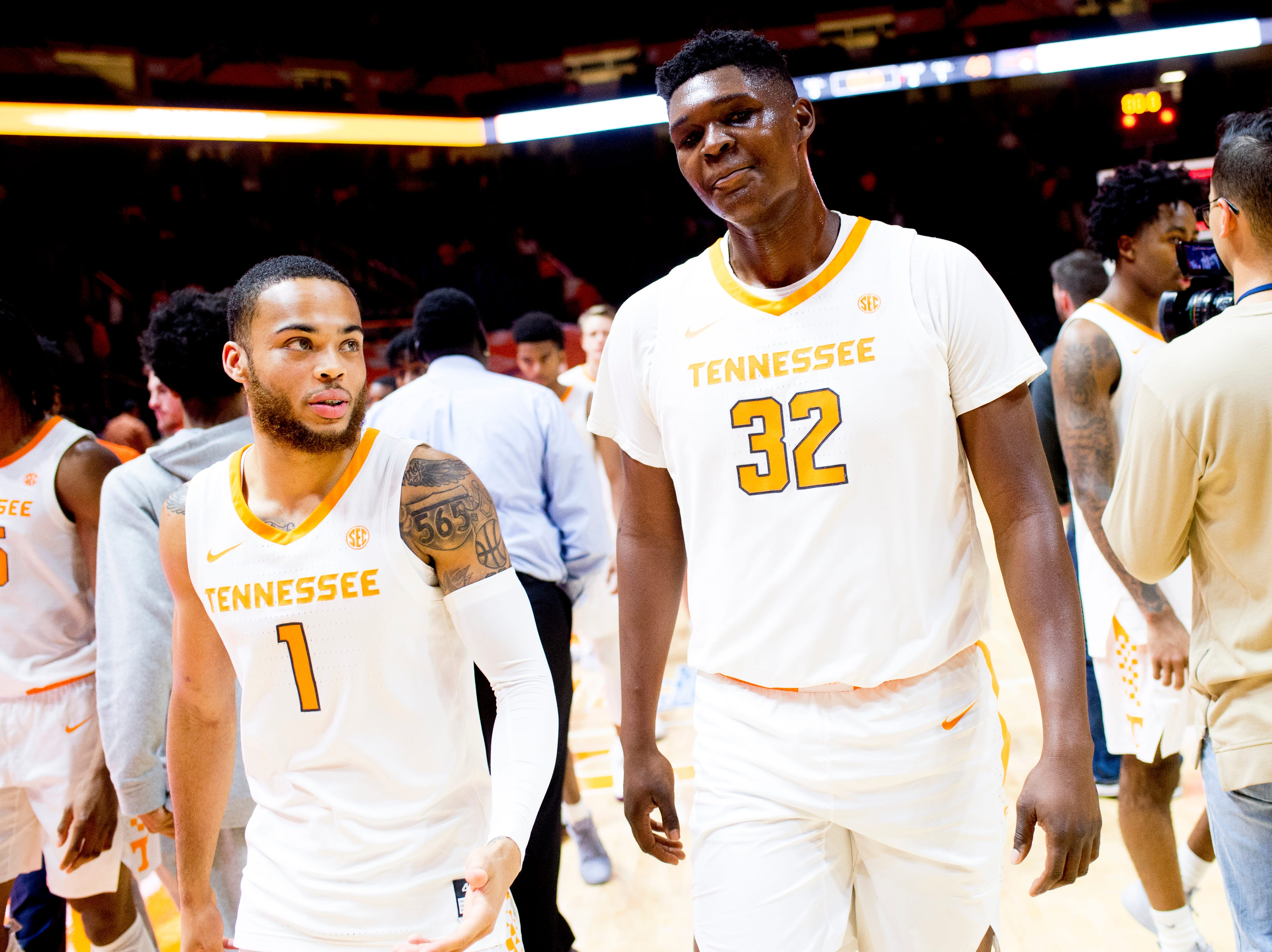 Tennessee guard Lamonte Turner (1) and Tennessee forward D.J. Burns (32) walk off the court after their 87-48 win over Tusculum at Thompson-Boling Arena in Knoxville, Tennessee on Wednesday, October 31, 2018.