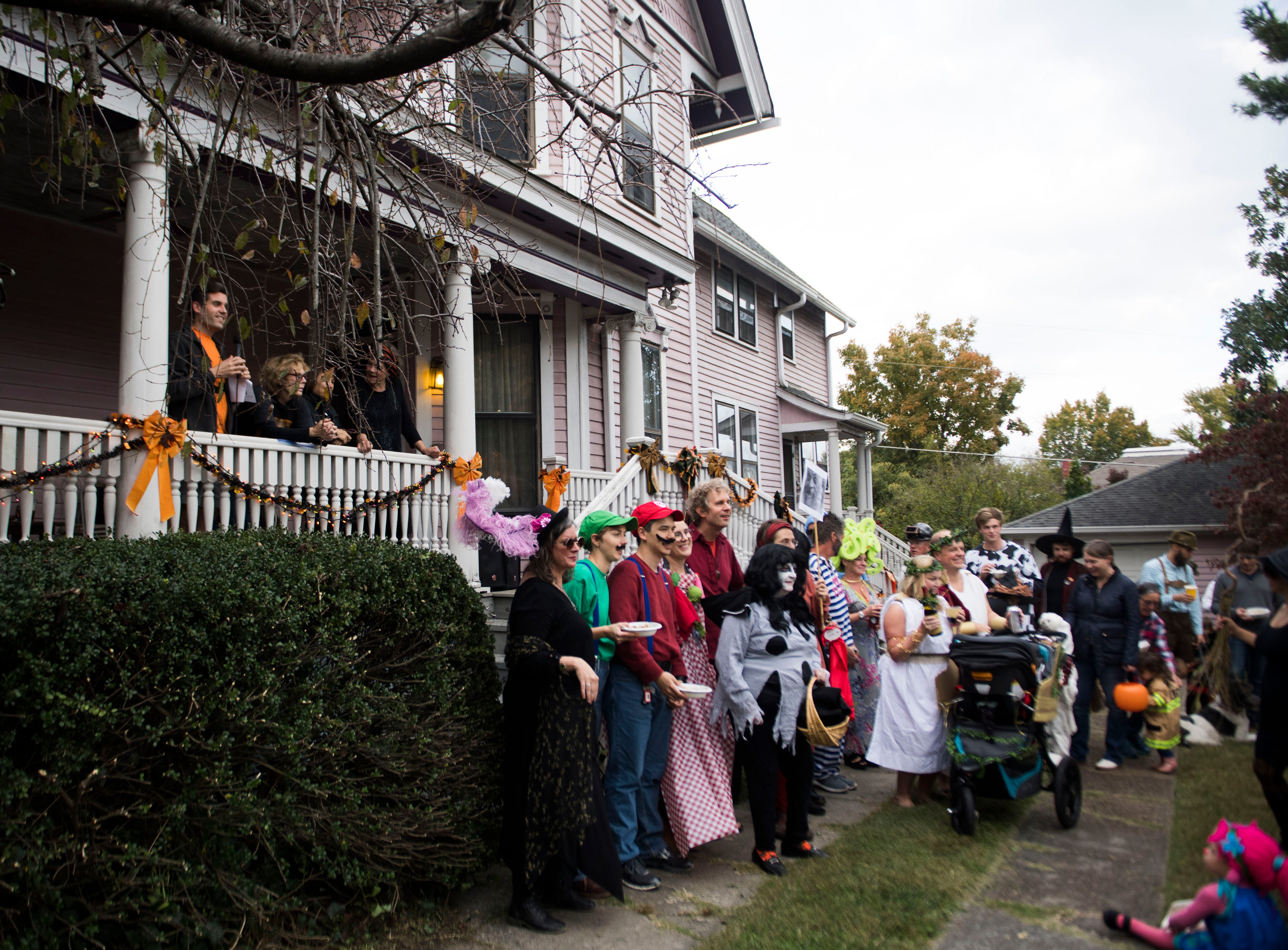 Adult costume contest participants gather for a photo at the Fourth and Gill neighborhood's Halloween party in Knoxville, Wed. Oct. 31, 2018.