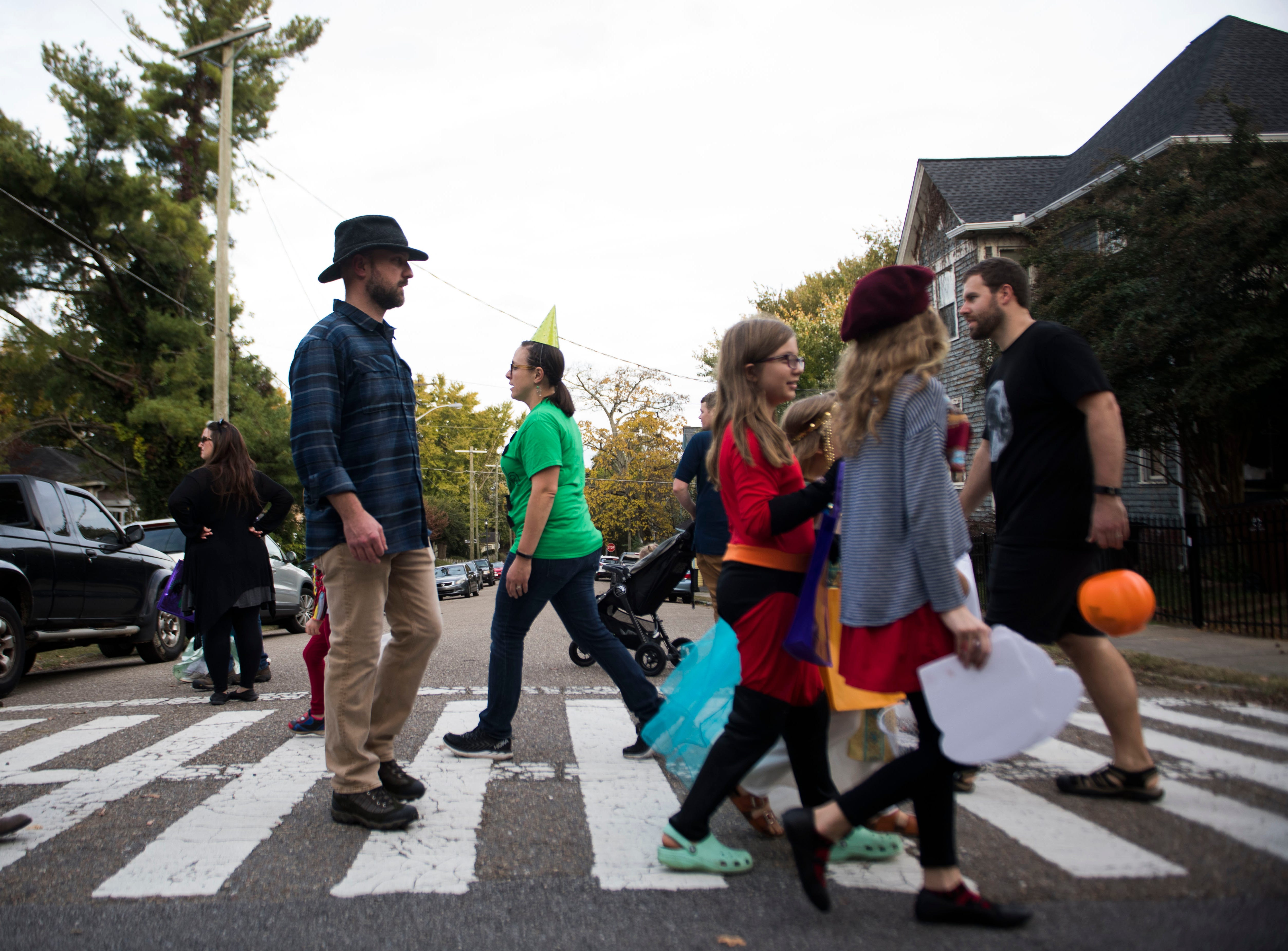 Trick-or-treaters cross the street in the Fourth and Gill neighborhood in Knoxville, Wed. Oct. 31, 2018.