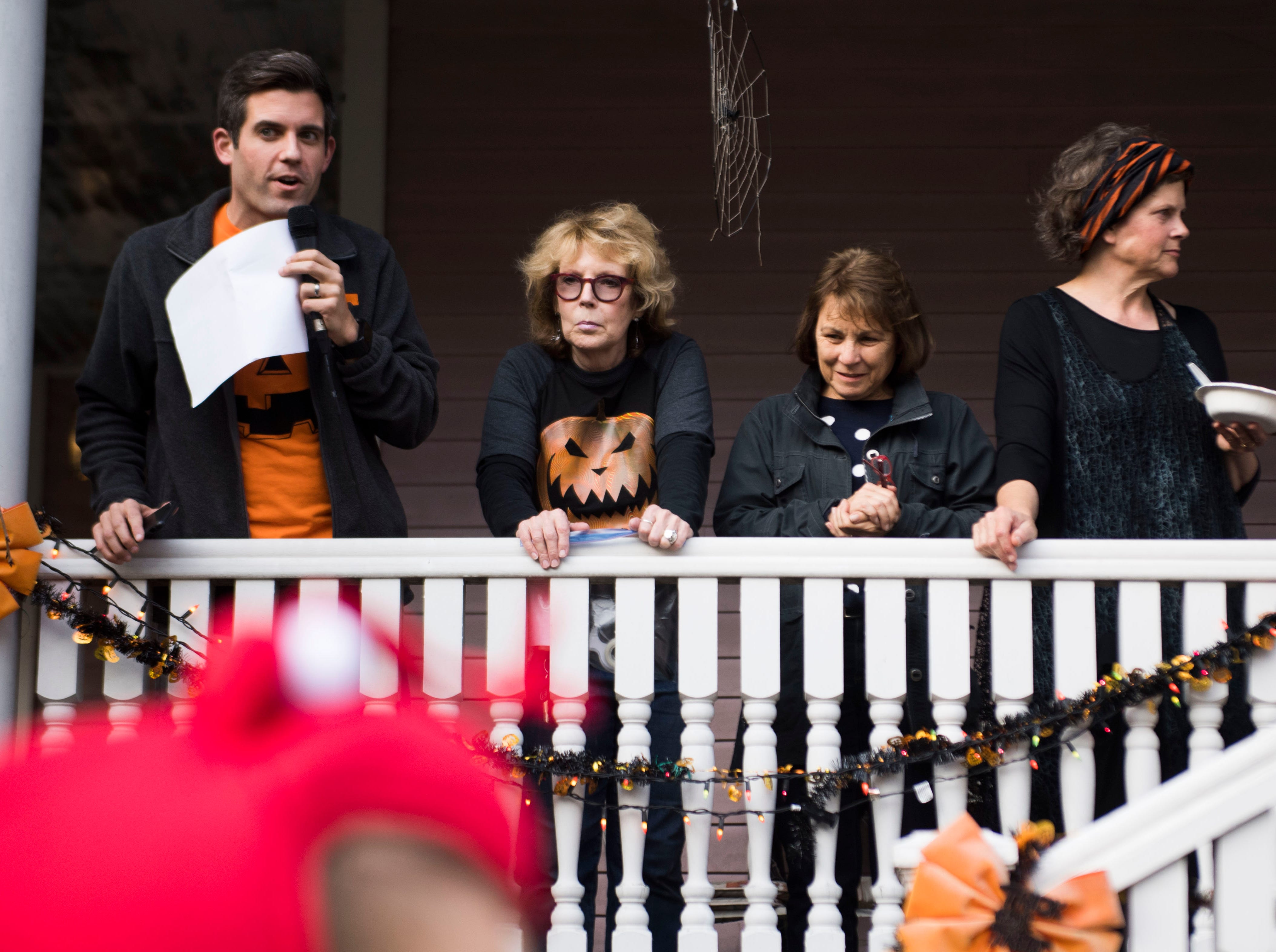 Judges for a Halloween costume contest survey participants at  Fourth and Gill's neighborhood Halloween party in Knoxville, Wed. Oct. 31, 2018.