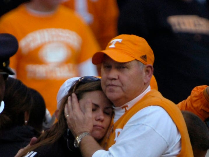 EMILY SPENCE/KNOXVILLE NEWS SENTINEL - Saturday, November 8, 2008 Coach Fulmer comforts daughter Allison at the end of the game. The Cowboys beat the Vols 13-7. The Tennessee Volunteers played the Wyoming Cowboys at Neyland Stadium.