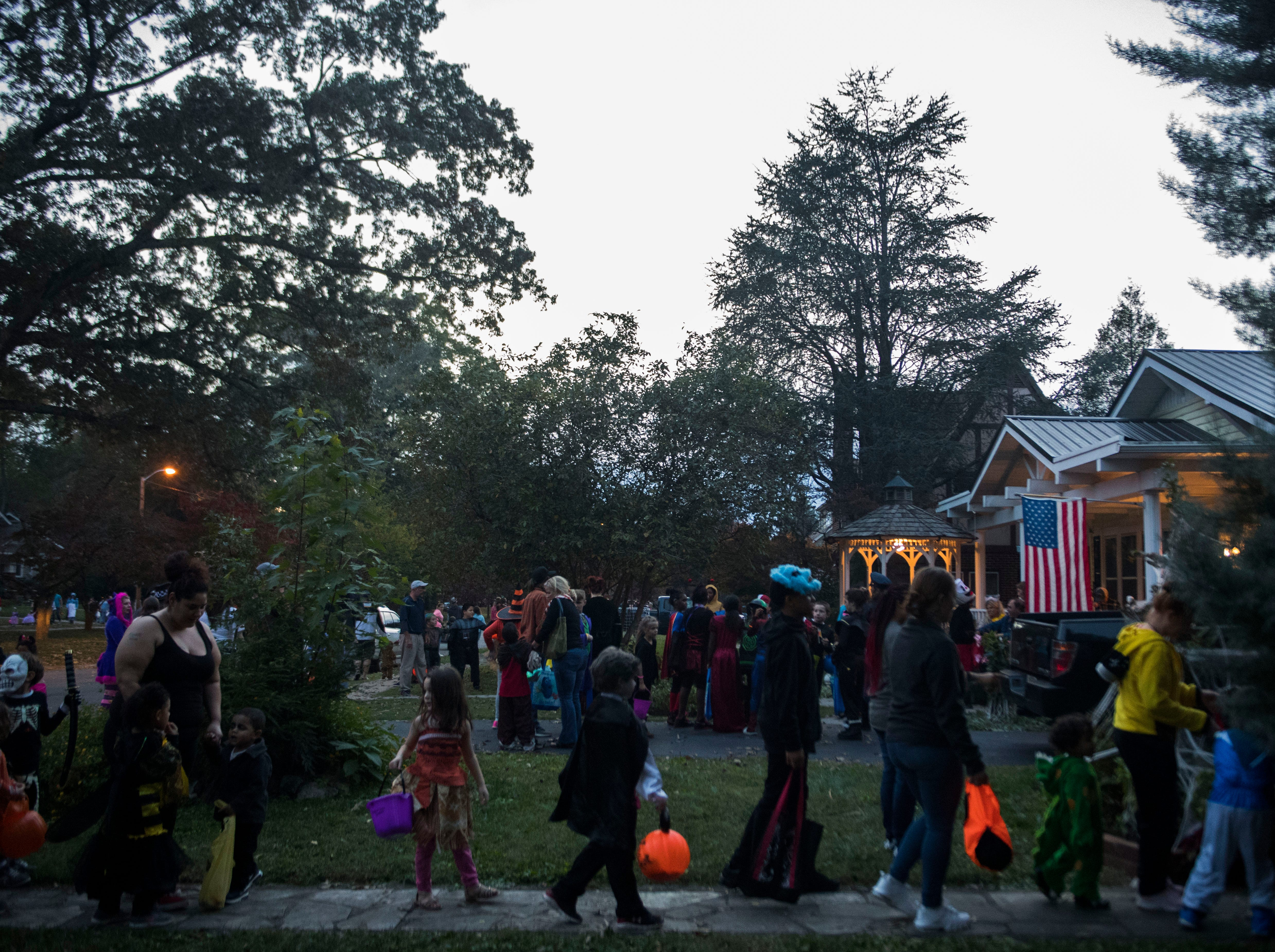 Children trick-or-treat in the Island Home neighborhood in Knoxville, Wed. Oct. 31, 2018.