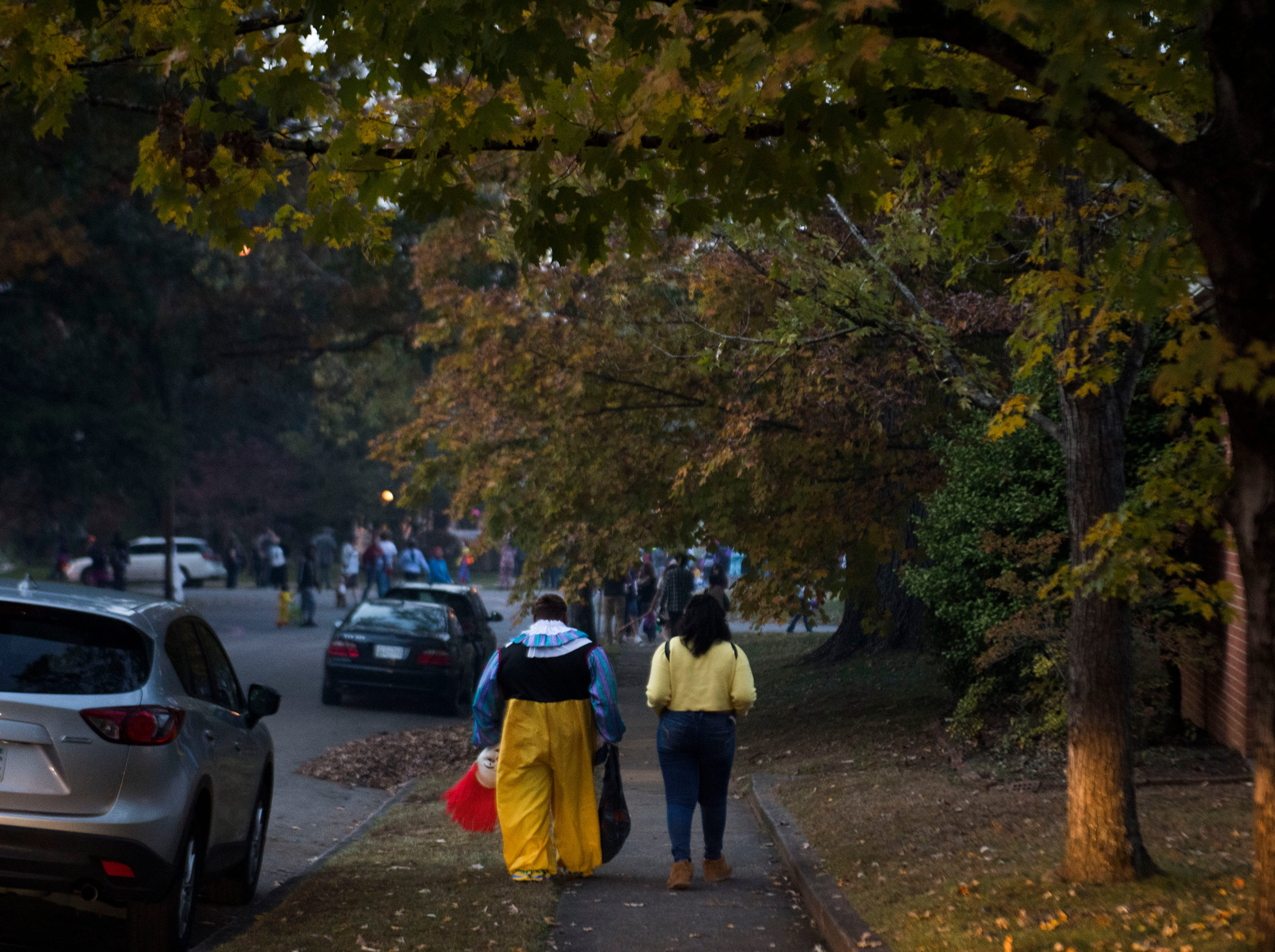 Trick-or-treaters walk in the Island Home neighborhood in Knoxville, Wed. Oct. 31, 2018.