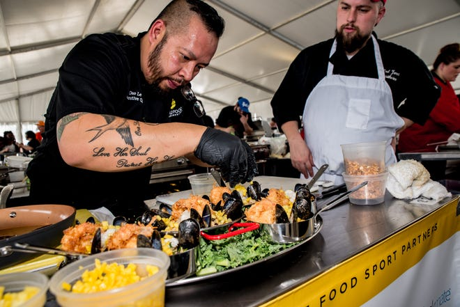 Competitors at the 2017 World Food Championships put final touches on a seafood dish.