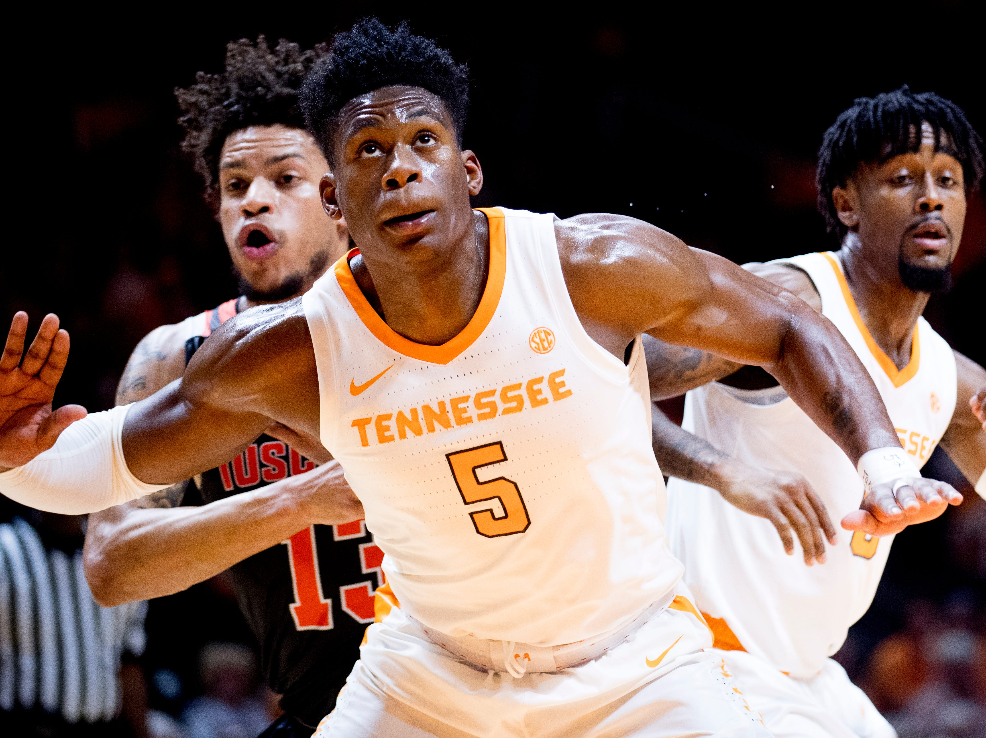 Tennessee guard Admiral Schofield (5) eyes the rebound past Tusculum forward Austin Hall (13) and Tennessee guard Jordan Bone (0) during a game between Tennessee and Tusculum at Thompson-Boling Arena in Knoxville, Tennessee on Wednesday, October 31, 2018.