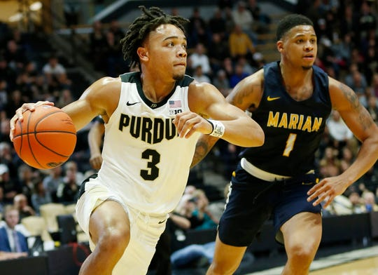 Carsen Edwards of Purdue turns the corner on TJ Henderson of Marian University in the first half Thursday, November 1, 2018, at Mackey Arena.