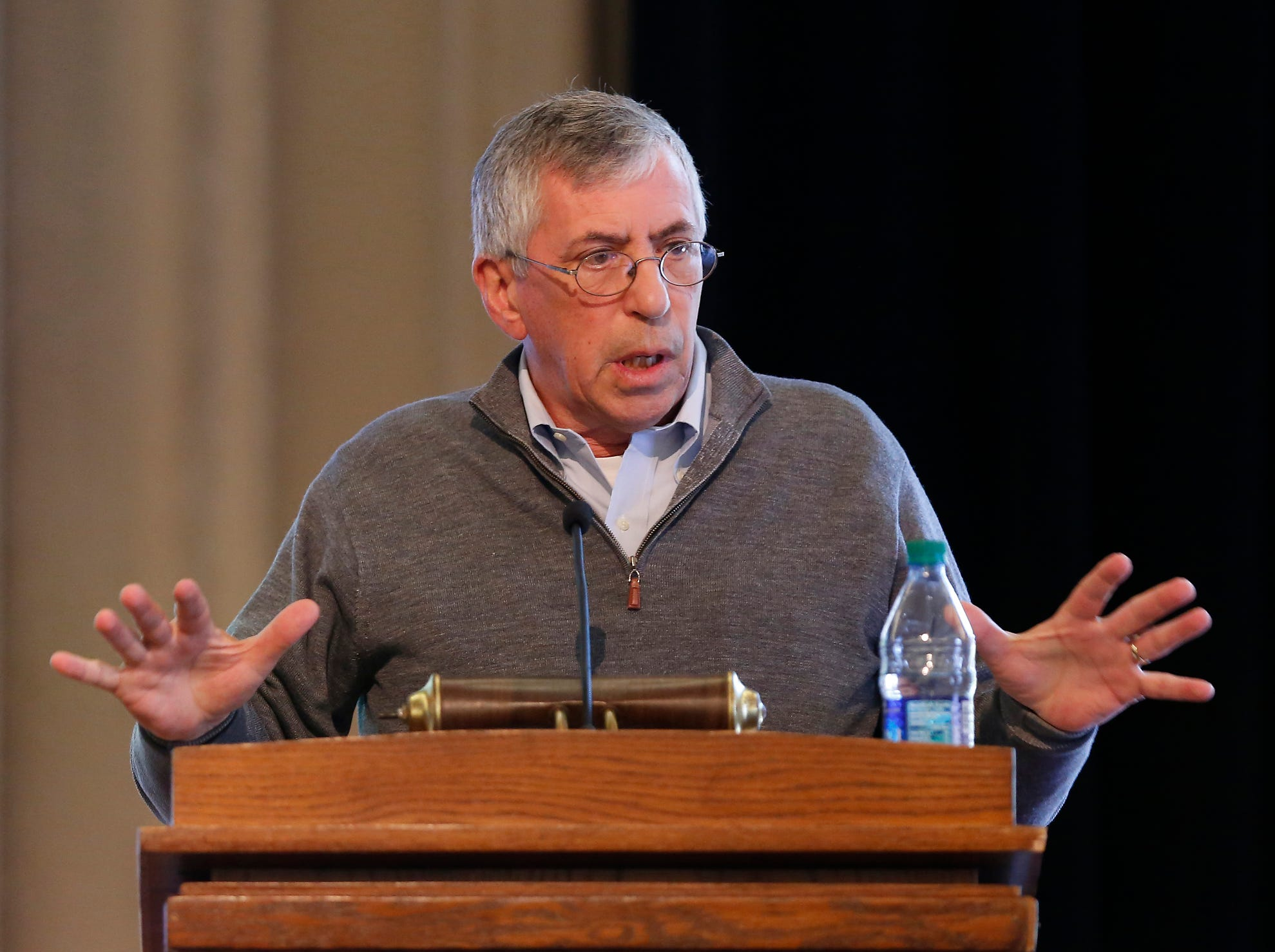 Bill Sullivan, treasurer and chief financial officer for Purdue, answers questions during a town hall meeting about changes to the healthcare benefits for university employees Wednesday, October 24, 2018, at the Purdue Memorial Union. Sullivan said savings realized from changes to healthcare benefits could be put into other endeavors, such as wages.