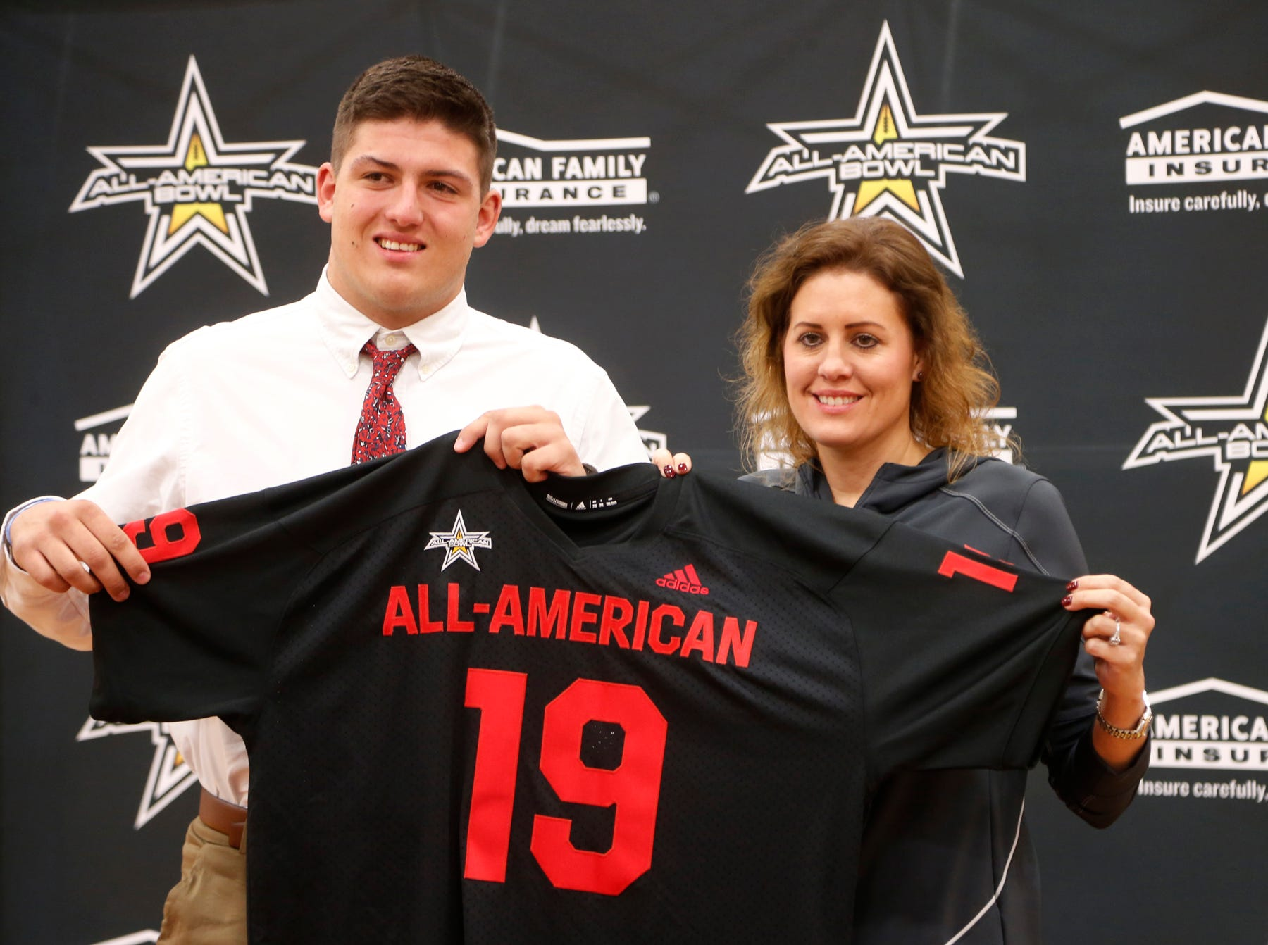 West Lafayette senior George Karlaftis is joined by his mother Amy moments after receiving his jersey for the All-American Bowl presented by American Family Insurance Monday, October 29, 2018, at West Lafayette High School.