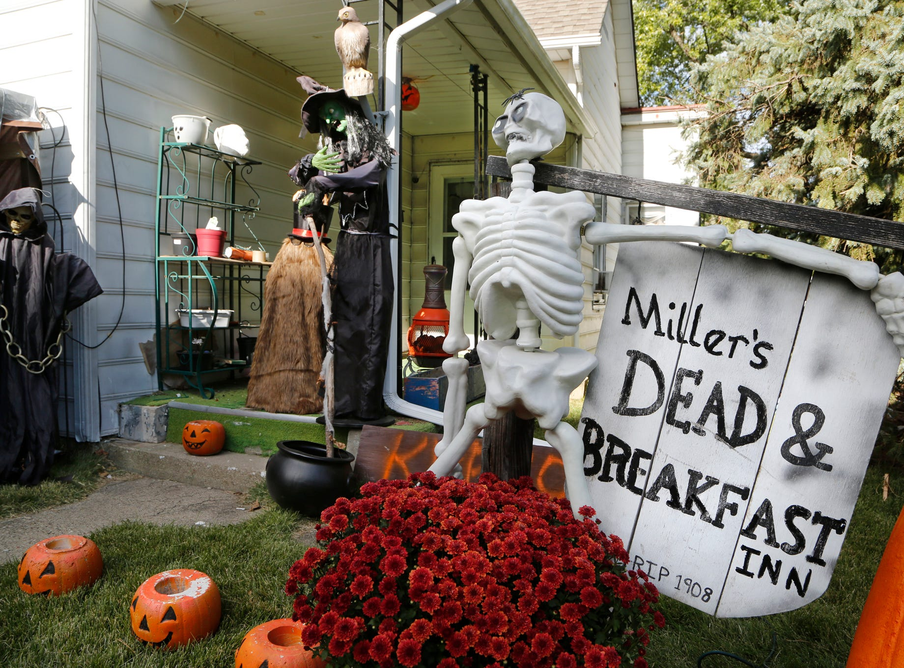 Halloween decorations cover the front yard of Ken and Connie Miller's home Tuesday, October 16, 2018, in the 2600 block of Main Street in Lafayette. The couple have been decorating their front yard for Halloween for about the past 15 years.