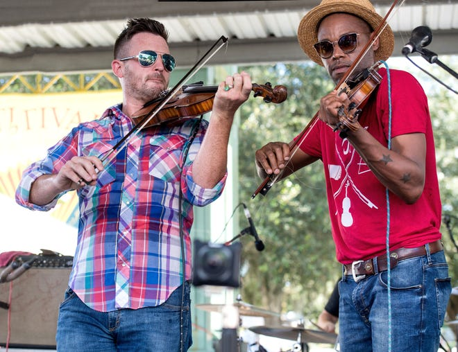 Jourdan Thibodeaux, left, and Cedric Watson perform at the 2018 Festivals Acadiens et Creoles in Girard Park.