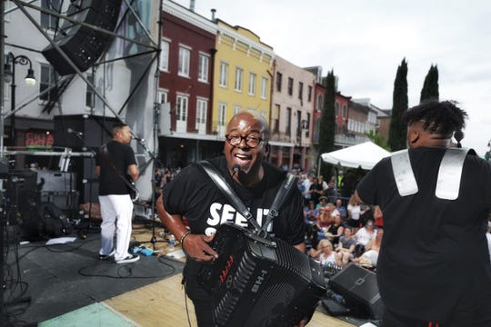 Sean Ardoin performs on stage at the French Quarter Festival in New Orleans.