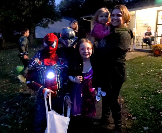 Trick-or-treaters go house to house on a wet Halloween night Wedensday, Oct. 31, 2018, on Shoshone and Mohawk drives in Lancaster.