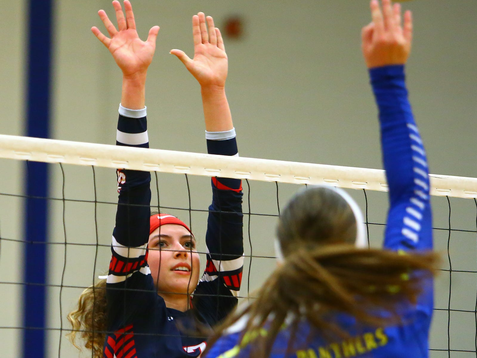 Fairfield Christian's Blaire Barr tries to block Portsmouth Clay Panther Jensen Warnock Wednesday night, Oct. 31, 2018, at Lancaster High School.
