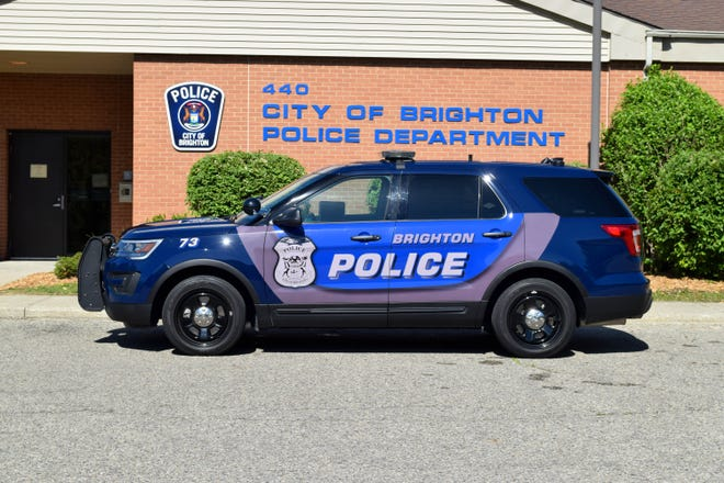A Brighton City police car is parked in front of the station in Brighton.