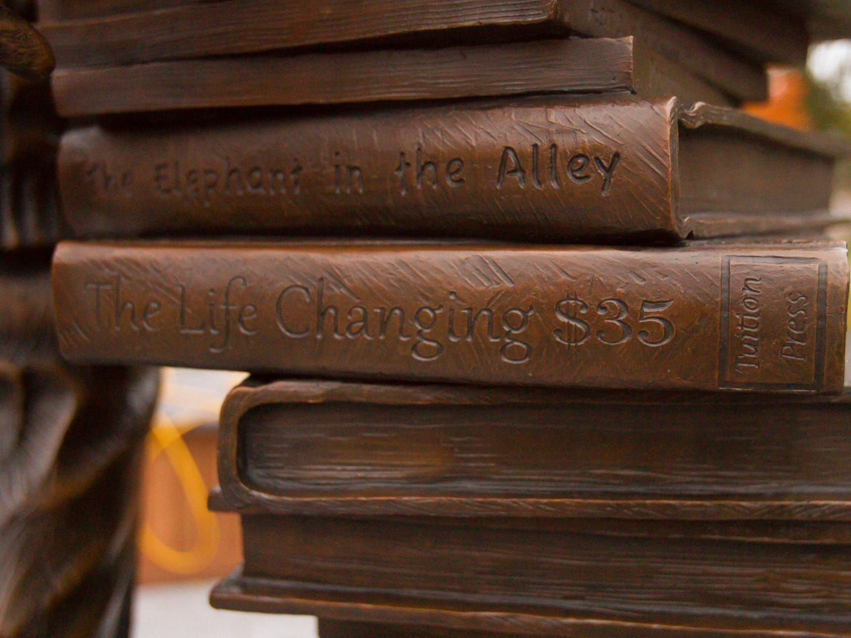 Each book in the Zemp Legacy statue has a title depicting a story of Duane Zemper's life. The statue was installed Thursday, Nov. 1, 2018 and would be unveiled Sunday.
