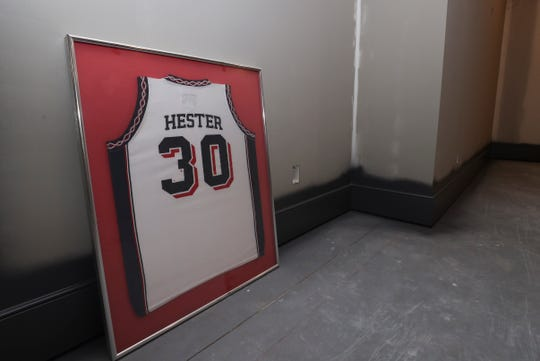 Christi Mack's Dayton hall of fame jersey is framed.