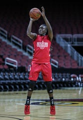 Louisville's Yancine Diop takes a shot during practice with the Cardinals Thursday afternoon at the KFC Yum Center.