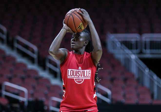 Louisville's Yancine Diop takes a shot during practice with the Cardinals Thursday afternoon at the KFC Yum! Center. Nov.1, 2018