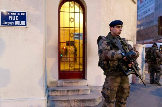French soldiers patrol with semiautomatic weapons outside synagogues and other Jewish sites