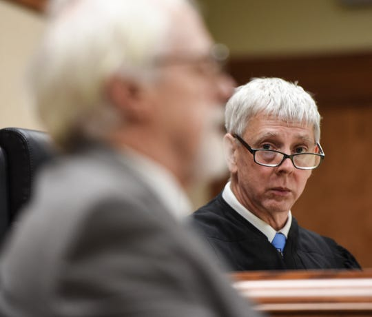 Clinton County District Court Judge Michael Clarizio listens to Bath artist Robert Park, Thursday, Nov. 1, 2018, during testimony about his Blue Loop installation.