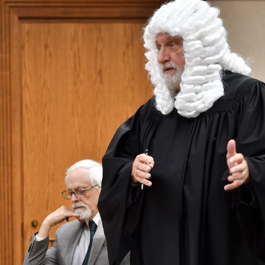 "William Metros, an attorney from Bath Township, dresses like an early barrister while defending Robert Park in Clinton County district court Wednesday, Oct. 31. Metros donned the Halloween costume to make the point that Bath Township is ""barreling headstrong toward the 17th century"" for requiring Park, an artist, to take down his art installation on his wooded property."