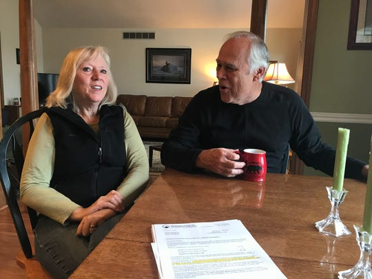 Linda and Mark Harbison discuss the state's outdated retiree health care payments at their dining room table in Perry Oct. 30, 2018.