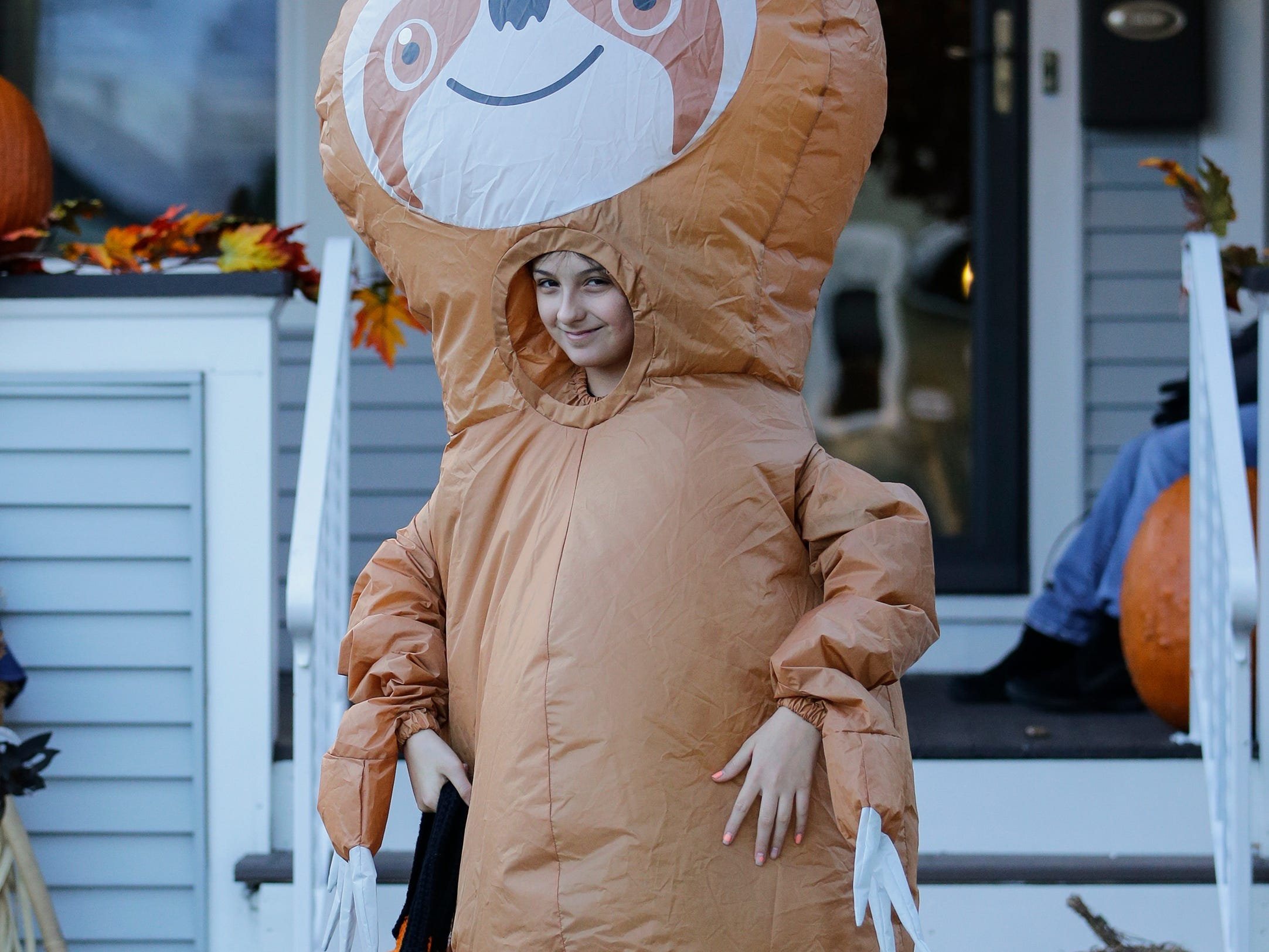Tatyana Arriaga trick or treats in a sloth costume on Halloween Wednesday, October 31, 2018, in Manitowoc, Wis. Joshua Clark/USA TODAY NETWORK-Wisconsin