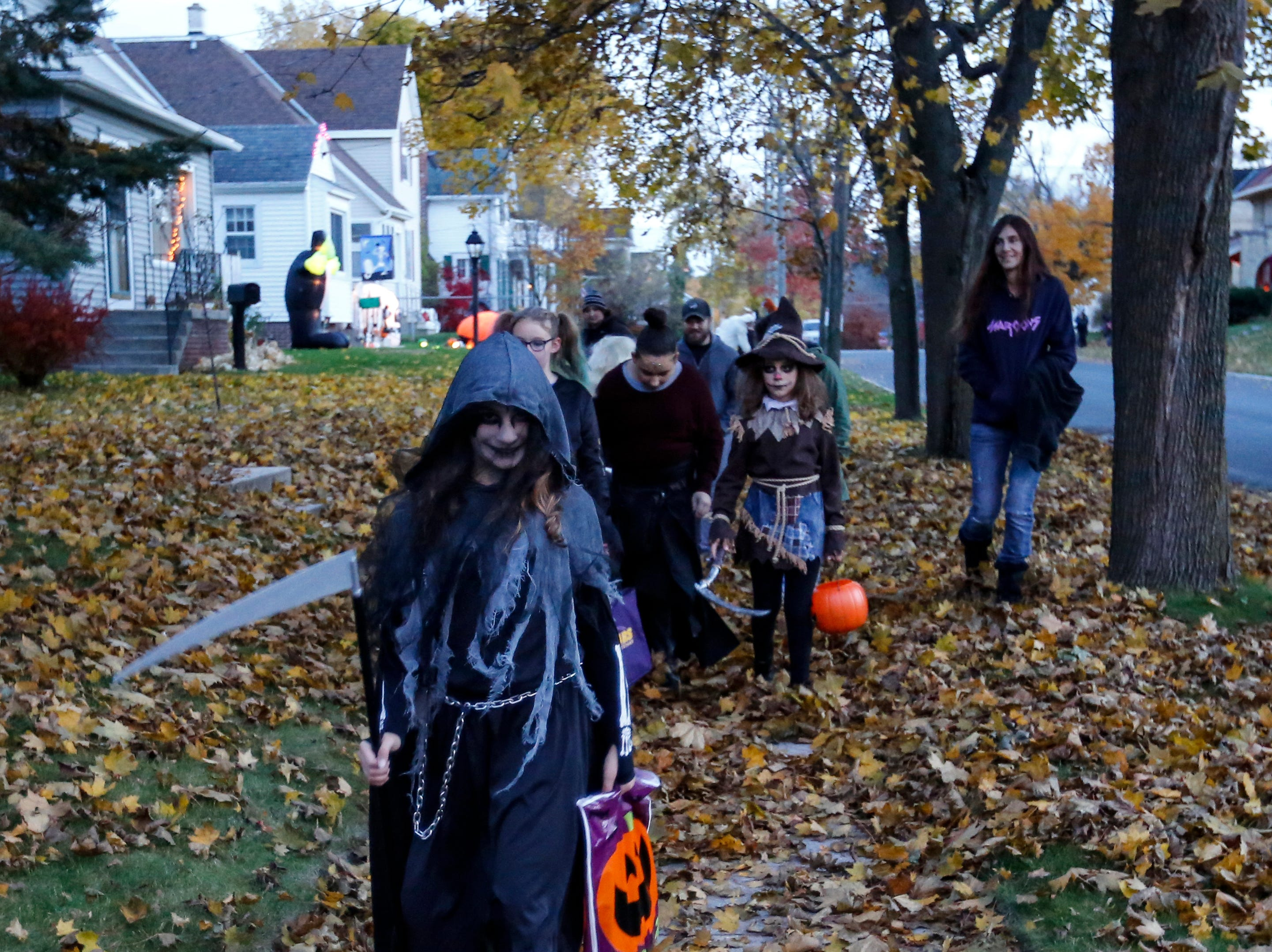 Kids go trick or treating on Halloween Wednesday, October 31, 2018, in Manitowoc, Wis. Joshua Clark/USA TODAY NETWORK-Wisconsin