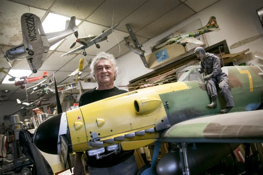 Lexington businessman Timothy Corwin stands with his hand built radio controlled German Messerschmitt. Corwin was recently featured on the History Channel show American Pickers.